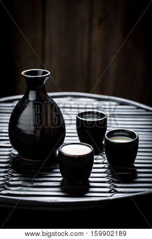 Delicious Sake In Black Ceramics On Black Table