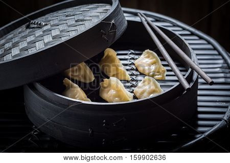 Fresh And Hot Chinese Dumplings In Bamboo Steamer
