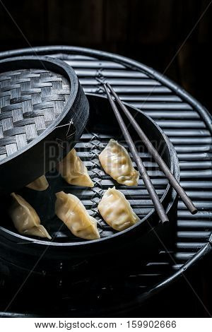 Delicious And Hot Chinese Dumplings In Bamboo Steamer
