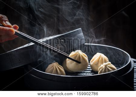 Yummy And Hot Chinese Dumplings In Bamboo Steamer