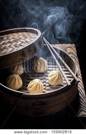 Yummy And Hot Chinese Dumplings In Wooden Steamer
