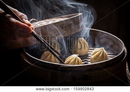 Boiled And Hot Chinese Dumplings In Wooden Steamer