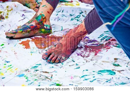 Feet Of Children Full Of Colorful Gouache