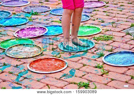Feet Of Children Full Of Colorful Gouache