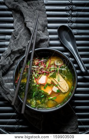 Delicious Miso Soup With Salmon In Black Bowl