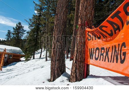 SnowCat Working Sign at Sipapu New Mexico a small town outside of Santa Fe, NM, USA at a snow covered winter wonderland a small Ski Resort.