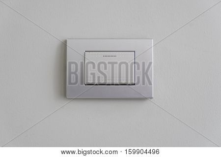 light switch on white wall for construction design concept - can use to display or montage on product