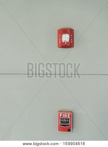 abstract concept of fire alarm and emergency light on gray wall - can use to display or montage on product