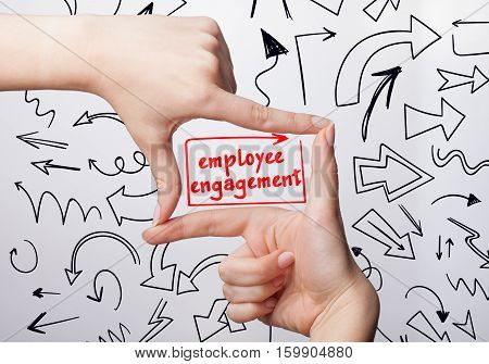 Technology, Internet, Business And Marketing. Young Business Woman Writing Word: Employee Engagement