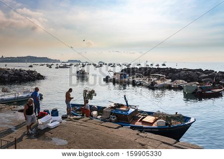 Naples Italy - August 30 2016: Italian fishermen start new day in port of Naples one of the biggest city in Italy