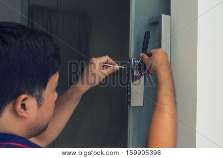 locksmith to fix a bathroom door with screwdriver on vintage filter - can use to display or montage on product