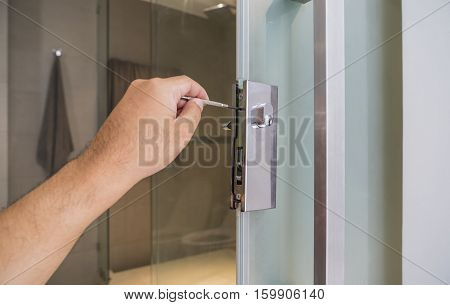 locksmith repair a silver lock on bathroom door - can use to display or montage on product