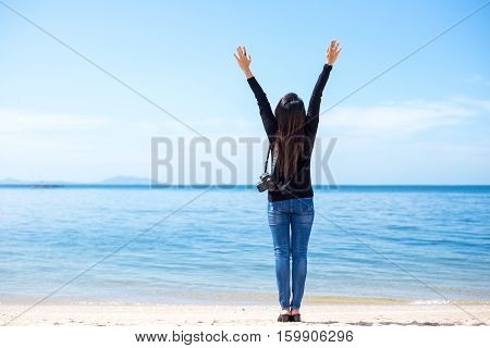 Traveler women see the beautiful beach and blue sky so happy and relax