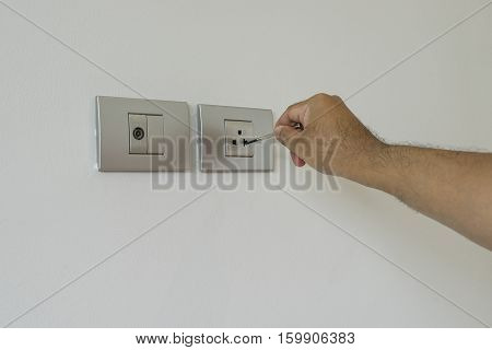 electrician test switch with screwdriver and unsafety scene - can use to display or montage on product
