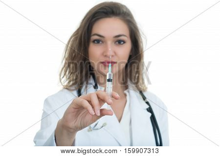 Female doctor checking a syringe isolated on white background.