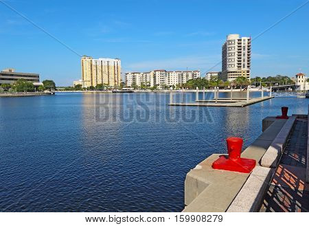Partial skyline of Tampa Florida with apartment and condominium buildings at the confluence of Seddon Channel and the Hillsborough River viewed from the Rivewalk near the Convention Center