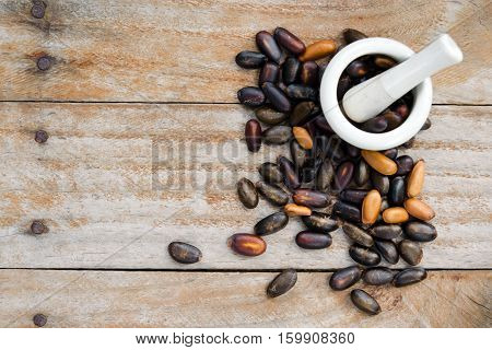 Heap Of Custard Apple Seeds Or Kernels Isolated On Wood With Blank Copy Text Space Top View