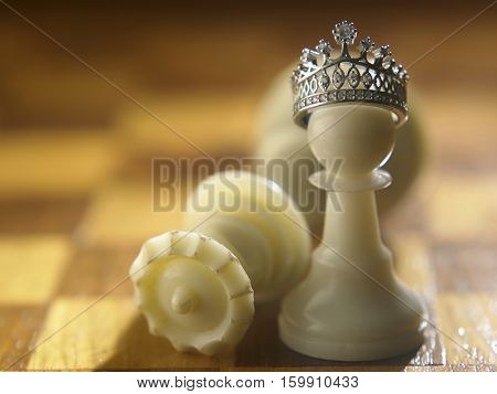 White chess pawn with the crown itself be a king