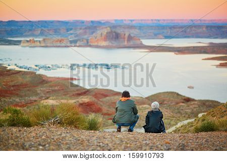 Romantic Couple Looking At The Powell Lake