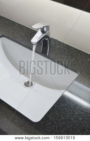 Water Tap And Under Counter Wash Basin With Black Granite Top