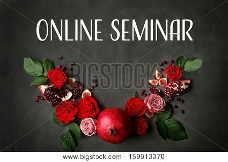 Text ONLINE SEMINAR with flowers and fruits on dark background. Florist and floral design tutorial concept.