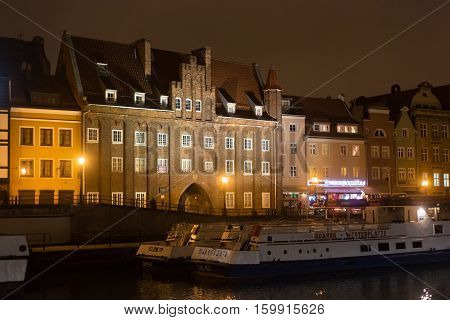 POLAND GDANSK - DECEMBER 12 2014: Historic buildings on the coast of the Motlawa river in the old part of the city. Gdansk is a Polish city on the Baltic coast and popular center of tourism.