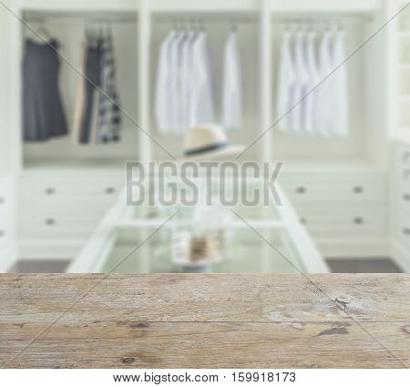 Wooden Counter Top With Blur Of Closet Room With White Hat And Jewelry Set On A Table