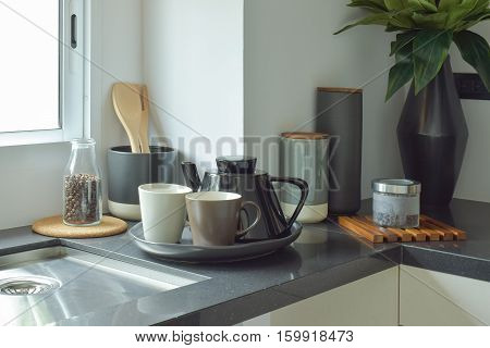 Ceramic Ware On Black Counter Top In The Kitchen