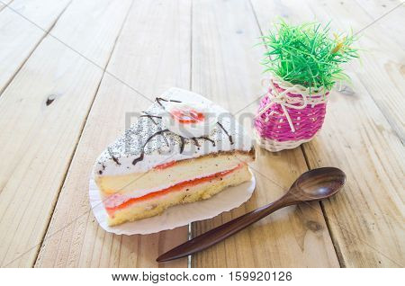 Piece of Vanilla Cake on wood table
