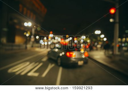 traffic on the night city street. one-way street. car and city street illumination. blurred background due to the concept