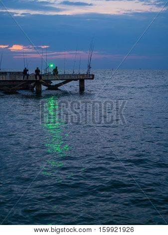 Bangsaen Chonburi Thailand - October 23 2016: Group of fisherman are fishing fish and squids with green lights.