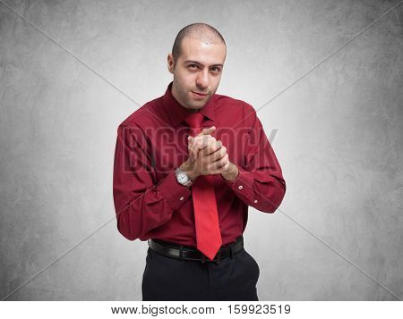 Shady businessman over a grey background