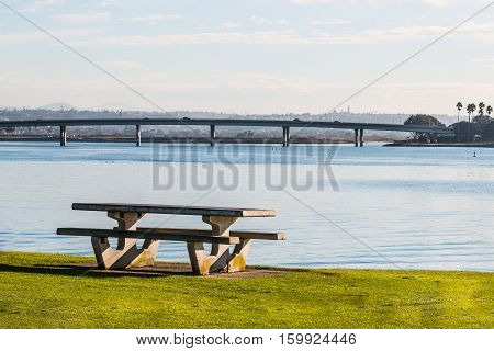 Picnic table in morning light at Ventura Cove Park on Mission Bay in San Diego, California