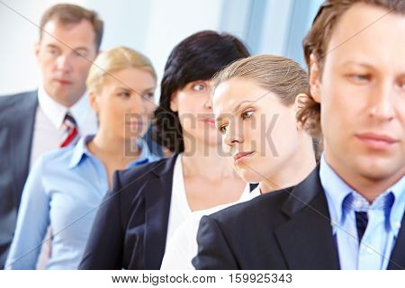 Disappointed young business team standing in Office