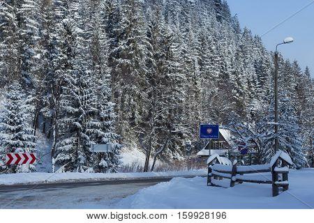 Polish-Slovak border post on the Lysa Polana in snowy forest in the High Tatras mountains. Border crossing on the road from Zakopane (Poland) to Tatranska Lomnica (Slovakia).