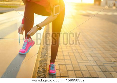 Woman Runner Tying Laces Before Training. Marathon.