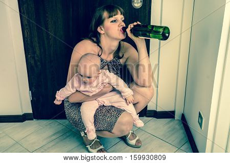 Drunk reckless woman drinking alcohol and holding her baby after return from night party - retro style