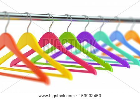 Colorful wooden cloth hangers on clothes rail on white defocused background. 3D illustration