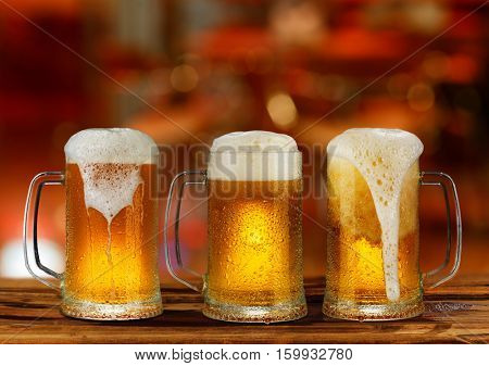 cold light beer glass mug in a pub.