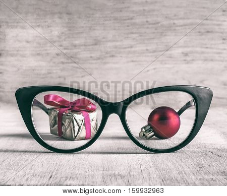 Business Christmas office workplace glasses and Christmas decorations. Business and holiday concept retro style