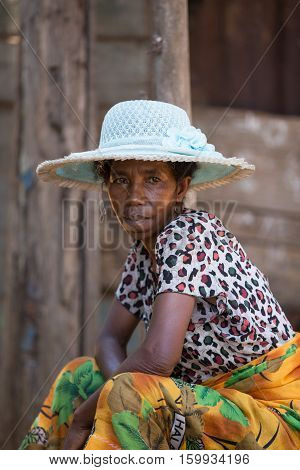 Portrait Of Old Malagasy Woman With Straw Hat