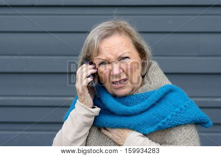 Confused Elderly Woman Chatting On Her Mobile