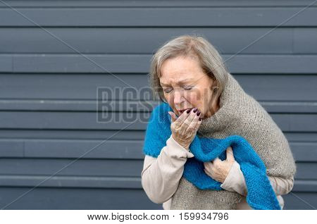 Elegant Senior Woman Coughing Into Her Hand