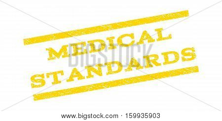 Medical Standards watermark stamp. Text caption between parallel lines with grunge design style. Rubber seal stamp with scratched texture. Vector yellow color ink imprint on a white background.