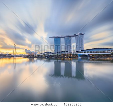 Singapore, Republic of Singapore - May 4, 2016: Marina Bay Sands hotel reflecting in sunrise water