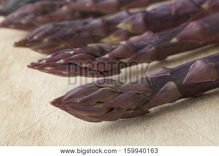 Tips of fresh purple asparagus