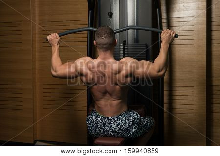 Fitness Muscle Man Exercise Back On Machine