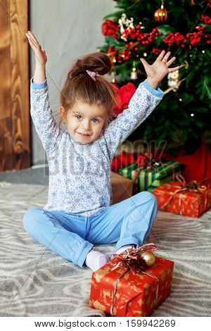 Happy baby opening presents. The concept of Christmas and New Year.