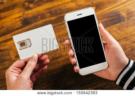 Woman holding smartphone and new SIM card mock up image