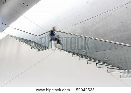 Blurred motion of women moving down stairs